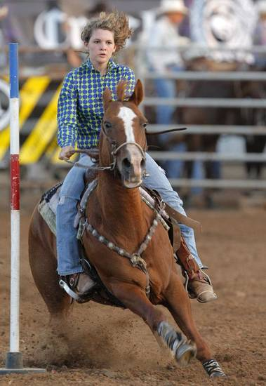 Becky Simmons of McClean, Texas participates in pole bending during the International Youth Rodeo Finals, Sunday, July 10, 2011.  Photo by Garett Fisbeck, The Oklahoman