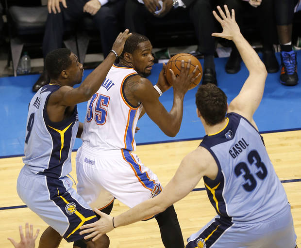 Oklahoma City's Kevin Durant (35) looks for room between Memphis' Tony Allen (9) and Marc Gasol (33) during Game 5 in the first round of the NBA playoffs between the Oklahoma City Thunder and the Memphis Grizzlies at Chesapeake Energy Arena in Oklahoma City, Tuesday, April 29, 2014. Photo by Nate Billings, The Oklahoman