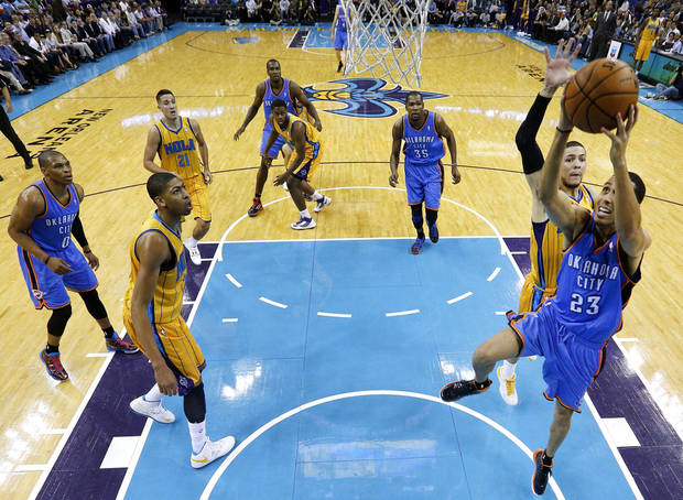 Oklahoma City Thunder guard Kevin Martin (23) goes to the basket against New Orleans Hornets guard Austin Rivers (25) during the first half of an NBA basketball game in New Orleans, Friday, Nov. 16, 2012. (AP Photo/Jonathan Bachman)