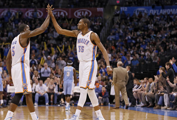 Oklahoma City's Kendrick Perkins (5) and Kevin Durant (35) react after a timeout during the NBA basketball game between the Oklahoma City Thunder and the Denver Nuggets at the Chesapeake Energy Arena on Wednesday, Jan. 16, 2013, in Oklahoma City, Okla.  Photo by Chris Landsberger, The Oklahoman