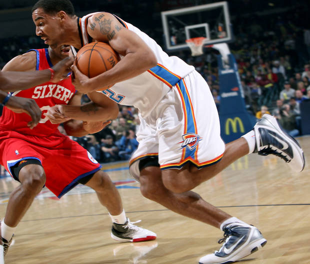 Oklahoma City's Thabo Sefolosha runs into pressure from Philadelphia's defense during the first half of their NBA basketball game at the Ford Center in Oklahoma City on Tuesday, Dec. 2, 2009. By John Clanton, The Oklahoman