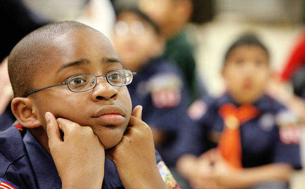 Demetri listens intently to a first aid presentation during the Cub Scout pack meeting at Villa Teresa School. PHOTOs BY DAVID MCDANIEL, THE OKLAHOMAN