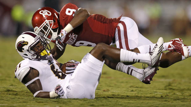 Oklahoma senior safety Gabe Lynn brings down Louisiana-Monroe's Rashon Ceaser during last week's 34-0 rout. PHOTO BY BRYAN TERRY, THE OKLAHOMAN