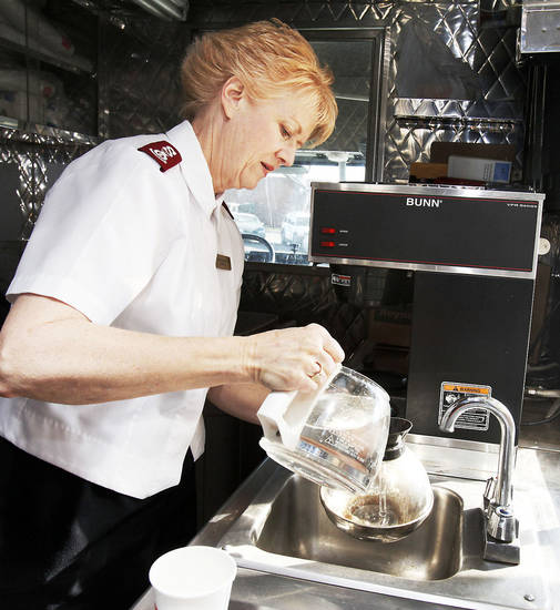 Maj. Leisa Hall, Salvation Army divisional secretary for women�s ministries, makes coffee for the  Salvation Army�s mobile kitchen.