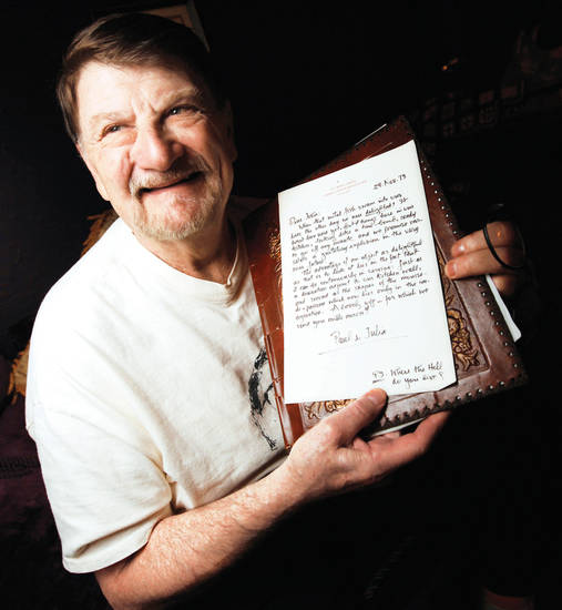 John Bennett holds one of his many letters from Julia Child.   Photo By Nate Billings, The Oklahoman