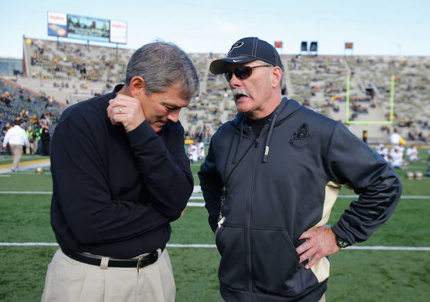 Iowa coach Kirk Ferentz, left, talks with Purdue coach Danny Hope before an NCAA college football game Saturday, Nov. 10, 2012, in Iowa City, Iowa. Purdue won 27-24. (AP Photo/The Gazette, Brian Ray)