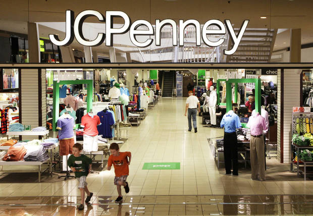 Shoppers walk in a J.C. Penney store in Plano, Texas.   AP Photo