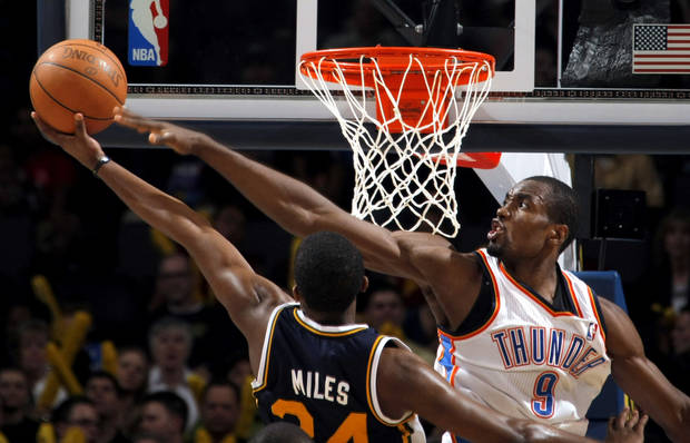Oklahoma City's Serge Ibaka (9) blocks Utah's Paul Millsap (24) shot during the NBA basketball game between the Oklahoma City Thunder and Utah Jazz, Wednesday, March 23, 2011, at the Oklahoma City Arena. Photo by Sarah Phipps, The Oklahoman