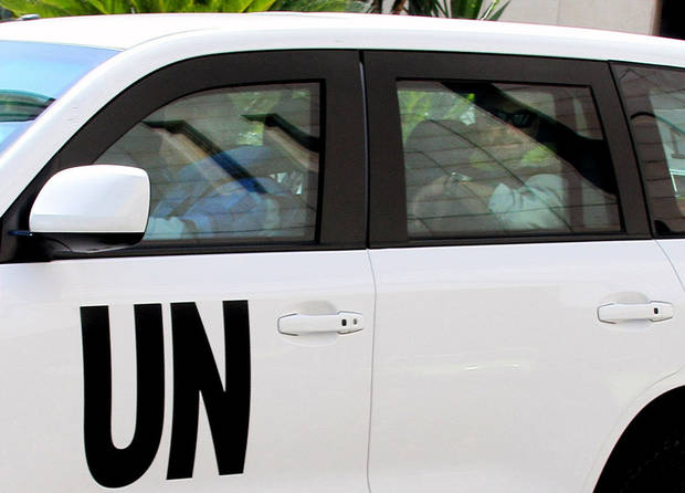 UN inspectors leave the Four Season Hotel in their vehicles in Damascus, Syria, Thursday, Aug. 29, 2013. U.N. experts investigating purported poison gas attacks left their Damascus hotel Thursday, but anti-regime activists said the team's destination was not immediately known. (AP Photo)