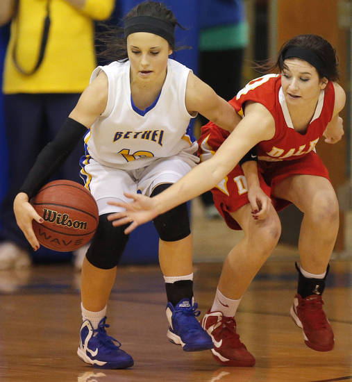 Dale's Raegan Holt tries to steal the ball away from Bethel's Meghan Tade during their girls high school basketball game at Bethel High School in Shawnee, Okla., Friday, Feb. 1, 2013. Photo by Bryan Terry, The Oklahoman