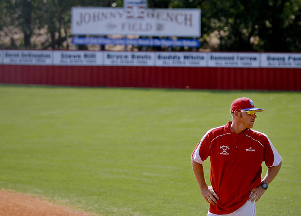 Former Major League Baseball player and current head coach of the Binger-Oney High School baseball team Reggie Willits looks on as he watches his team warm up during pre game on Thursday, Sept. 20, 2012, in Binger, Okla. Photo by Chris Landsberger, The Oklahoman