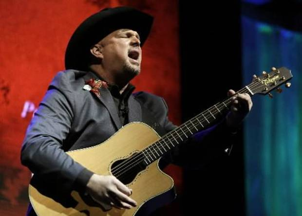 "Garth Brooks sings ""Papa Loved Mama,"" a song written by Kim Williams, as Williams is inducted into the Nashville Songwriters Hall of Fame on Sunday, Oct. 7, 2012, in Nashville, Tenn."