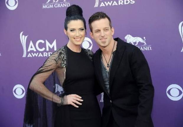 Shawna Thompson, left, and Keifer Thompson, of musical group Thompson Square, arrive at the 48th Annual Academy of Country Music Awards at the MGM Grand Garden Arena in Las Vegas on Sunday, April 7, 2013. (AP)