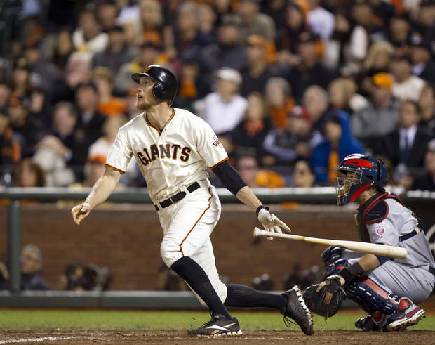 San Francisco Giants right fielder Hunter Pence (8) watches his ball fly deep to right during Game 1 of baseball's National League championship series against the St. Louis Cardinals on Sunday, Oct. 14, 2012, in San Francisco. (AP Photo/The Sacramento Bee, Paul Kitagaki Jr.) MAGS OUT; LOCAL TV OUT (KCRA3, KXTV10, KOVR13, KUVS19, KMAZ31, KTXL40); MANDATORY CREDIT