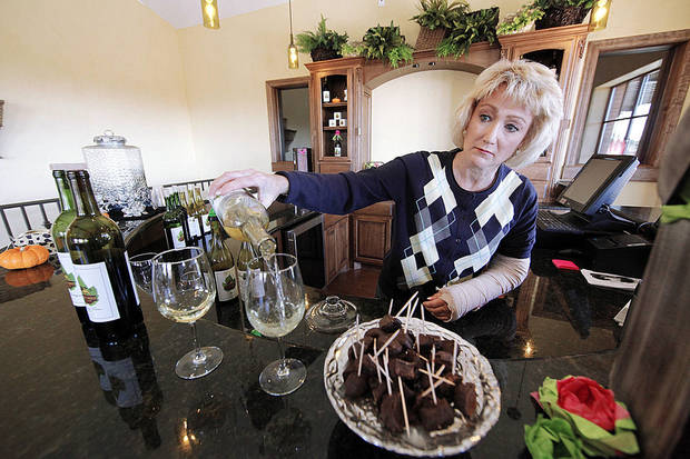 Kim Ingmire pours a glass of wine in the tasting room at Clauren Ridge Vineyard and Winery, which she and her husband own. Photo by STEVE GOOCH, THE OKLAHOMAN