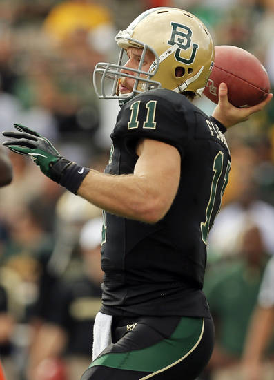 Baylor's Nick Florence (11) passes during a college football game between the Oklahoma State University Cowboys (OSU) and the Baylor University Bears at Floyd Casey Stadium in Waco, Texas, Saturday, Dec. 1, 2012. Photo by Nate Billings, The Oklahoman