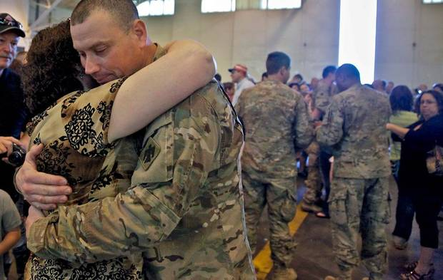 Jeff Lawson hugs his mother Jean during the return ceremony for the National Guard's 45th Infantry Brigade Combat Team troops at the National Guard Base on Thursday, March 15, 2012, in Oklahoma City, Oklahoma.  Photo by Chris Landsberger, The Oklahoman
