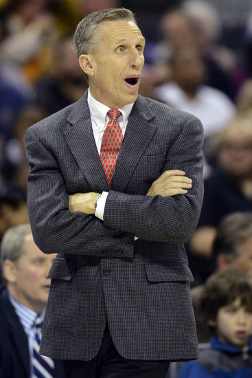 Charlotte Bobcats head coach Mike Dunlap discusses a call with an official during the second half of their NBA basketball game against the Miami Heat, Wednesday, Dec. 26, 2012, in Charlotte. The Heat won 105-92. (AP Photo/The Charlotte Observer, David T. Foster III) MAGS OUT; TV OUT; NEWSPAPER INTERNET ONLY