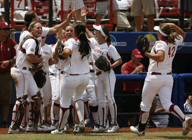 Oklahoma celebrates during a Women's College World Series game between Oklahoma University and Arizona State University at ASA Hall of Fame Stadium in Oklahoma City, Sunday, June 3, 2012.  Photo by Garett Fisbeck, The Oklahoman