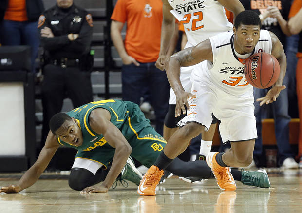 Oklahoma State 's Marcus Smart (33) gets a steal on Baylor's Deuce Bello (14) during the college basketball game between the Oklahoma State University Cowboys (OSU) and the Baylor University Bears (BU) at Gallagher-Iba Arena on Wednesday, Feb. 5, 2013, in Stillwater, Okla. Photo by Chris Landsberger, The Oklahoman
