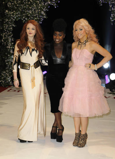 From left, X Factor contestants Janet Devlin, Misha Bryan and Amelia Lily arrive for the UK film premiere of 'Twilight Breaking Dawn Part 1' at Westfield Stratford in east London, Wednesday, Nov. 16, 2011. (AP Photo/Joel Ryan) ORG XMIT: LENT119