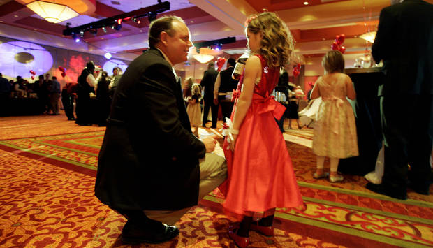Ford Fentriss pauses for a second with his daughter Kyla Fentriss, 6, of Norman at the Daddy Daughter Dance Sat. Feb. 7, 2009 at the Embassy Suites in Norman. BY JACONNA AGUIRRE, THE OKLAHOMAN.