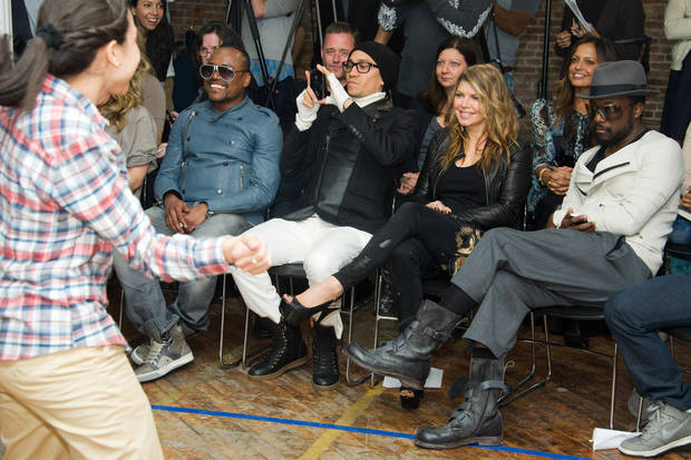 The Black Eyed Peas members, from right, will.i.am, Fergie, Taboo and apl.de.ap, watch students dance at the launch of a new Peapod Adobe Youth Voices Academy in New York, Tuesday, April 19, 2011. (AP Photo/Charles Sykes)