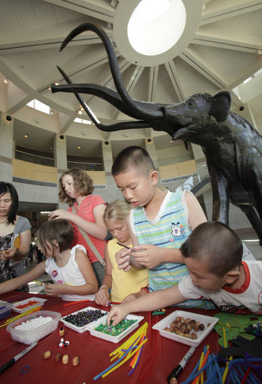 "Children make ""book worms"" during Library Day at the Sam Noble Oklahoma Museum of Natural History in Norman. OKLAHOMAN ARCHIVE PHOTOs"