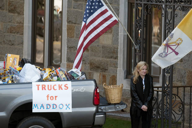 A woman collects toy trucks at the funeral of 2-year-old Maddox Derkosh at Saint Bernard Church in Mount Lebanon, Pa., on Friday, Nov. 9, 2012. Derkosh was killed Sunday after he fell from a wooden railing overlooking the painted dogs exhibit at the Pittsburgh Zoo and PPG Aquarium and bled to death after being mauled by the dogs. Derkosh's parents requested the toys instead of flowers because their son liked to play with trucks and share them with friends. More than 3,000 have been donated, and the William Slater II funeral home says it will continue accepting the trucks even after the boy's funeral Friday morning. The family intends to donate the trucks to a charity that will distribute them to needy children on Christmas. (AP Photo/Tribune Review, Justin Merriman) PITTSBURGH OUT