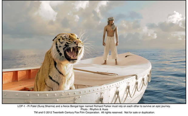 "Pi (Suraj Sharma) is trapped in a lifeboat with a ferocious Bengal tiger in ""Life of Pi."" TWENTIETH CENTURY FOX PHOTO <strong></strong>"