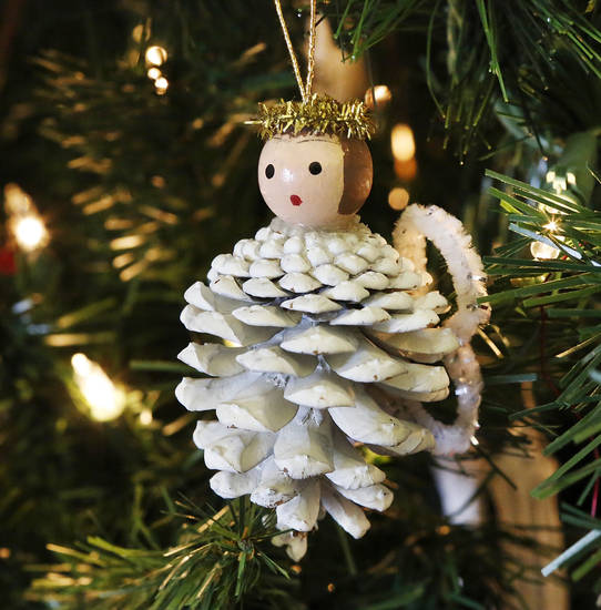 An angel made from a pine cone hangs on the tree at Will Rogers Garden Exhibition Center.