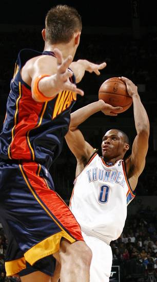 Oklahoma City's Russell Westbrook shoots over the defense of Golden State's Andris Biedrins in the first half during the NBA basketball game between the Golden State Warriors and the Oklahoma City Thunder at the Ford Center in Oklahoma City, Monday, December 8, 2008. BY NATE BILLINGS, THE OKLAHOMAN