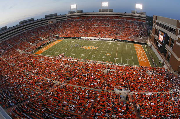 OVERVIEW / CROWD: Cowboy fans fill Boone Pickens Stadium during the first half of the college football game between the Oklahoma State University Cowboys (OSU) and the Texas A&M University Aggies (TAM) at Boone Pickens Stadium on Saturday, Oct. 4, 2008, in Stillwater, Okla.  CHRIS LANDSBERGER, THE OKLAHOMAN  ORG XMIT: KOD