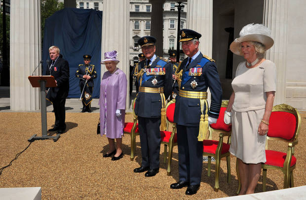   Britain&#039;s Queen Elizabeth II, Prince Philip, Prince Charles and the Duchess of Cornwall attend the unveiling of the Bomber Command Memorial in Green Park, London, Thursday June 28, 2012. The memorial honors the 55,573 men of the RAF&#039;s Bomber Command who died in World War II. (AP Photo/John Stillwell, Pool)  