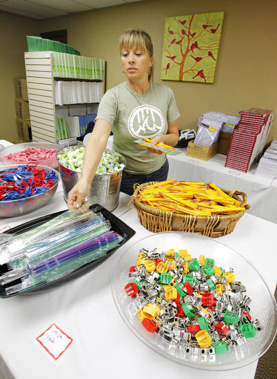 Volunteer Leigh Scully, from Edmond, putting out school supplies for foster children to select from at Citizens Caring for Children in Oklahoma City Monday, July 23, 2012.  Photo by Paul B. Southerland, The Oklahoman