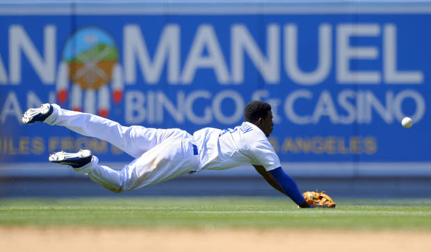 Los Angeles Dodgers shortstop Dee Gordon can't reach a ball hit for a double by St. Louis Cardinals' Pete Kozma during the seventh inning of their baseball game, Sunday, May 26, 2013, in Los Angeles. (AP Photo/Mark J. Terrill)
