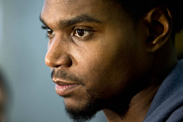 "FILE - In this Oct. 24, 2012 file photo, Philadelphia 76ers center Andrew Bynum listens to a reporter's question at the team's NBA basketball training facility in Philadelphia. Bynum will miss at least five more weeks because of a bone bruise in his right knee and may not play in a game until early January. Philadelphia said Monday, Nov. 12, 2012, that the new goal was for Bynum to resume ""normal basketball activity"" around Dec. 10. (AP Photo/Matt Rourke, File)"