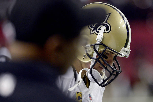 New Orleans Saints quarterback Drew Brees (9) paces on the sideline in the final seconds of their 23-13 loss to the Atlanta Falcons in an NFL football game, Thursday, Nov. 29, 2012, in Atlanta. (AP Photo/Rich Addicks)