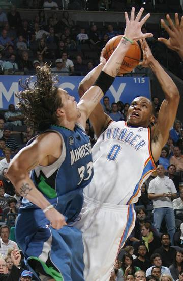 FIRST REGULAR SEASON WIN: Oklahoma City's Russell Westbrook tries to shoot over Mike Miller of Minnesota during the NBA basketball game between the Oklahoma City Thunder and the Minnesota Timberwolves at the Ford Center in Oklahoma City, Sunday, Nov. 2, 2008. The Thunder won, 88-85. BY NATE BILLINGS, THE OKLAHOMAN  ORG XMIT: KOD