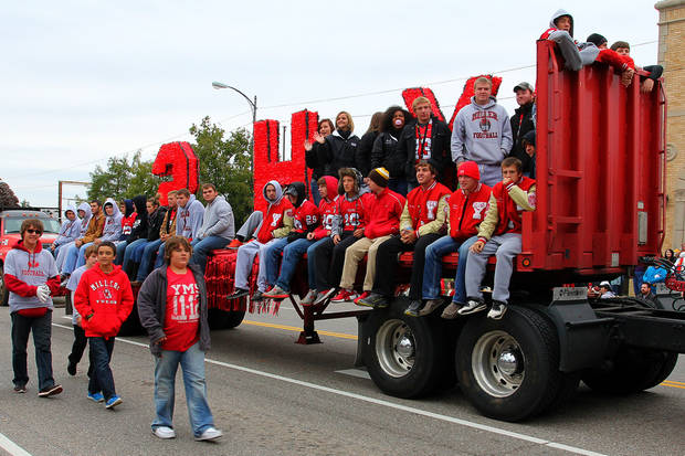 The Yukon High School football team rides on a float during the parade at the 47th annual Czech Festival Saturday in Yukon. PHOTO BY HUGH SCOTT FOR THE OKLAHOMAN