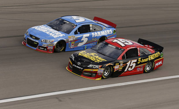 Kasey Kahne (5) and Clint Bowyer (15) make their way around Turn 4 during practice for the NASCAR Sprint Cup Series auto race, Saturday, March 9, 2013, in Las Vegas. (AP Photo/Julie Jacobson)