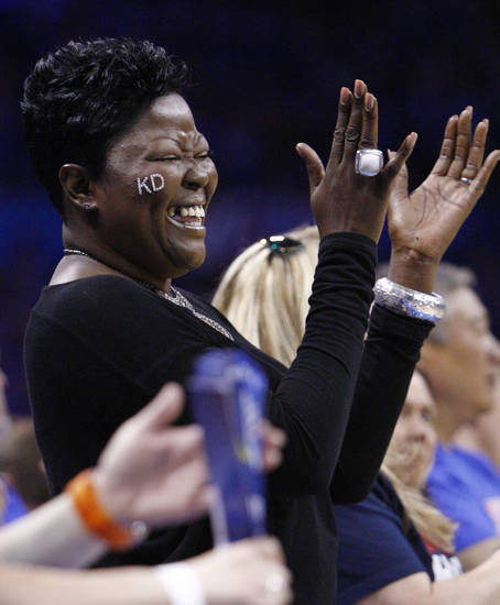 Wanda Pratt, mother of Oklahoma City Thunder forward Kevin Durant, cheers during the second quarter of Game 7 of a second-round NBA basketball playoff series between the Thunder and the Memphis Grizzlies in Oklahoma City, Sunday, May 15, 2011. (AP Photo/Sue Ogrocki)