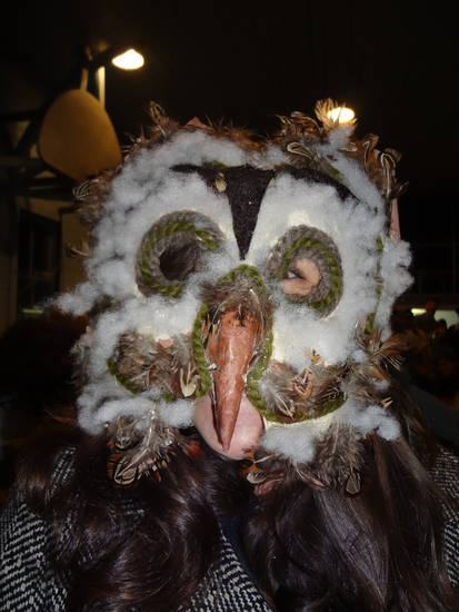 A reveler at the annual Fasnacht festival in Helvetia, W.Va., shows off one of the hundreds of homemade masks that people made to try to scare off Old Man Winter on Saturday, Feb. 9, 2013. (AP Photo/Vicki Smith)