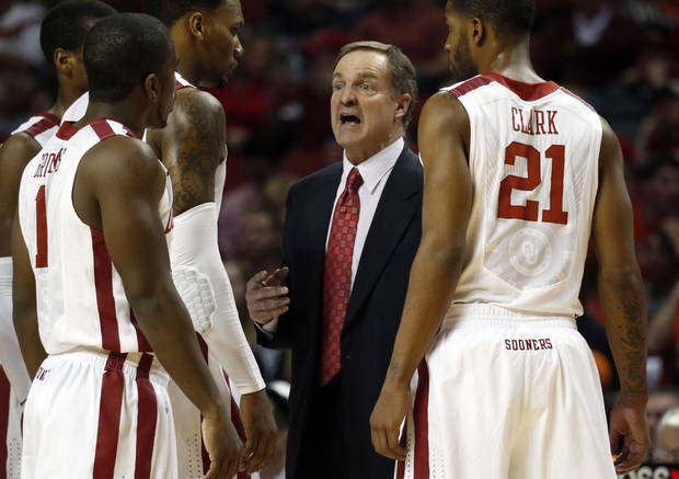 Sooner head coach Lon Kruger talks with his team during the second half as the University of Oklahoma Sooners (OU) defeat  the Oklahoma State Cowboys (OSU) 77-68  in NCAA, men's college basketball at The Lloyd Noble Center on Saturday, Jan. 12, 2013  in Norman, Okla. Photo by Steve Sisney, The Oklahoman