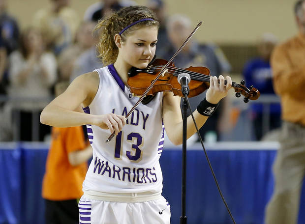 GIRLS HIGH SCHOOL BASKETBALL / STATE TOURNAMENT: Okarche's Rae Grellner plays the national anthem before the Class A girls state championship game between Okarche and Cheyenne/Reydon in the State Fair Arena at State Fair Park in Oklahoma City, Saturday, March 2, 2013. Photo by Bryan Terry, The Oklahoman