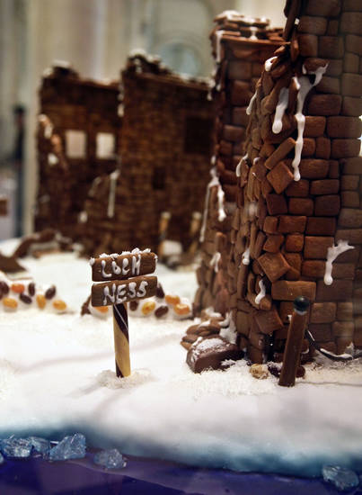 "This Nov. 30, 2012 photo shows a gingerbread creation from Rolling Pin Productions ""Loch Ness and the Urquhart Castle in Scotland,"" in the lobby area of Le Parker Meridien hotel in New York.  The landmark-inspired creation is being exhibited with other over-the-top gingerbread houses from city chefs in the annual display to benefit City Harvest, a food rescue organization for feeding the needy.  (AP Photo/Bebeto Matthews)"