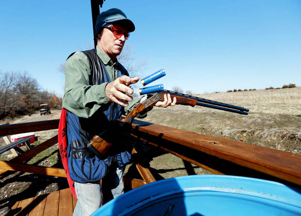Tony Greenberg, of Oklahoma City, reloads his shotgun Wednesday at Quail Ridge Sporting Clays.  Photo by Steve Sisney, The Oklahoman