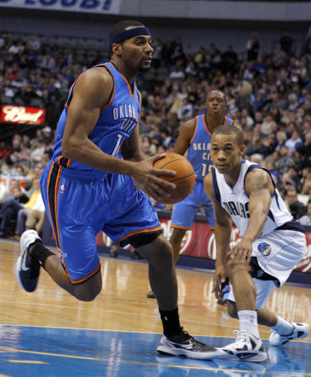 Oklahoma City's Lazar Hayward (11) drives to the basket by Dallas' Jerome Randle  during the pre season NBA game between the Dallas Mavericks and the Oklahoma City Thunder at the American Airlines Center in Dallas, Sunday, Dec. 18, 2011. Photo by Sarah Phipps, The Oklahoman
