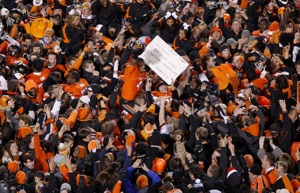 Oklahoma State's Justin Gilbert (4) celebrates with fans following the Bedlam college football game between the Oklahoma State University Cowboys (OSU) and the University of Oklahoma Sooners (OU) at Boone Pickens Stadium in Stillwater, Okla., Saturday, Dec. 3, 2011. Photo by Bryan Terry, The Oklahoman