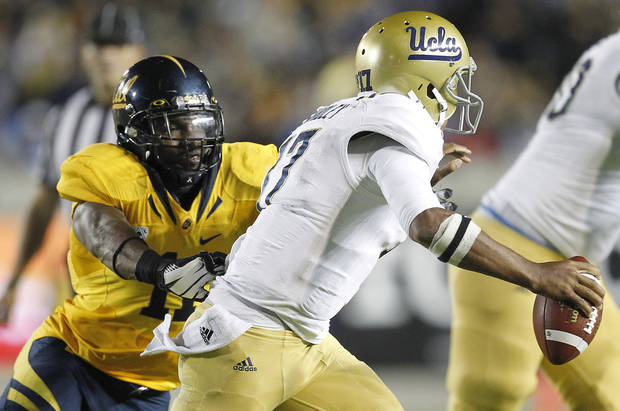 California linebacker Nick Forbes (11) sacks UCLA quarterback Brett Hundley (17) during the second half of an NCAA college football game in Berkeley, Calif., Saturday, Oct. 6, 2012. California won 43-17. (AP Photo/Tony Avelar)